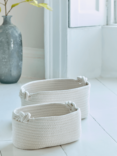Two Cream Woven Baskets
