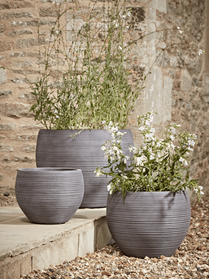 Three Grey Ribbed Curved Planters